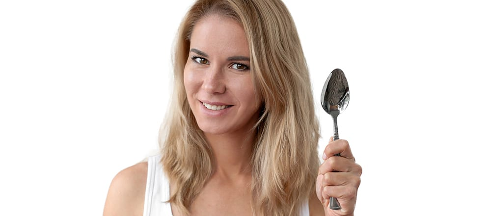Picture of lady holding a spoon in her hand